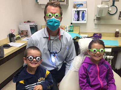 Dr. David Koepsel and kids doing thier dental treatments