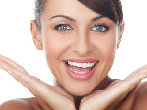 Invisalign Dentist Wichita KS - Woman Smiling after dentist treats