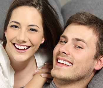 Image of a Happy couple smilling with showing thir brighter teeth